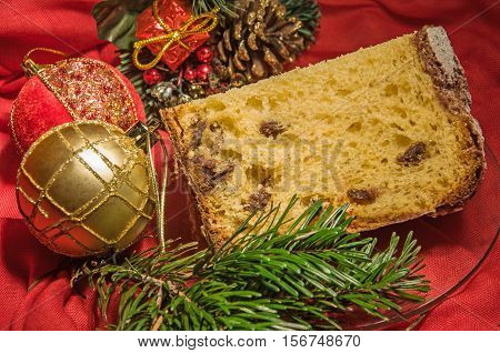 Good Piece Of Homemade Panettone On Holiday Background. Christmas Theme.