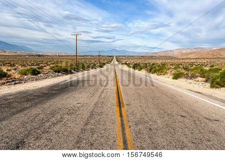 Two lane desert highway between Indio and Palm Springs California