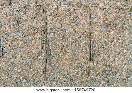 Texture Of Rubble Of Concrete With Rusty Iron Rod And Blue Boulder