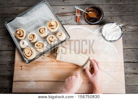 Girl Makes Homemade Cinnamon Buns