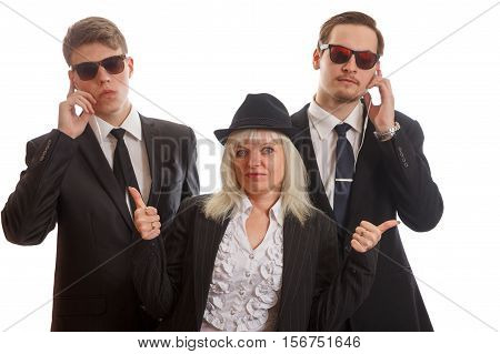 A woman with two bodyguards behind her