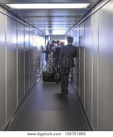 People Enter The Aircraft Via A Passenger Bridge