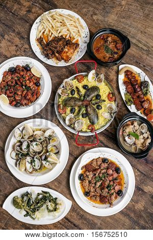 mixed portuguese traditional rustic tapas food gourmet selection on wood table poster