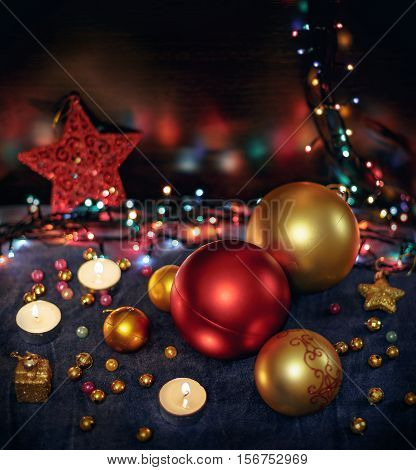 Christmas Toned blurred background with festive decoration. Christmas balls, candels, star, lights. Copy space