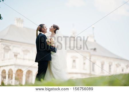 Wedding Couple Background Old Vintage Castle. Happy Newlyweds At Their Wedding Day.