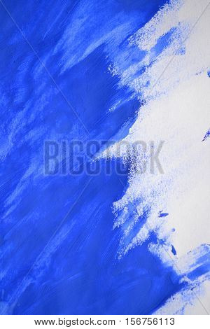 brushstrokes of blue paint made by a finger