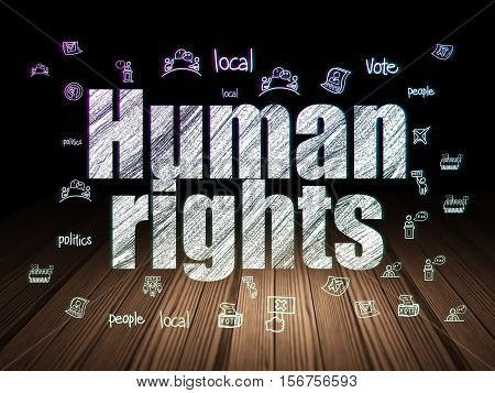 Political concept: Glowing text Human Rights,  Hand Drawn Politics Icons in grunge dark room with Wooden Floor, black background