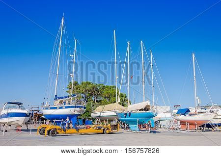 Shipyard for repair yacht and boats. Pier with ships.