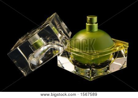 Opened Perfume Bottle Over Black