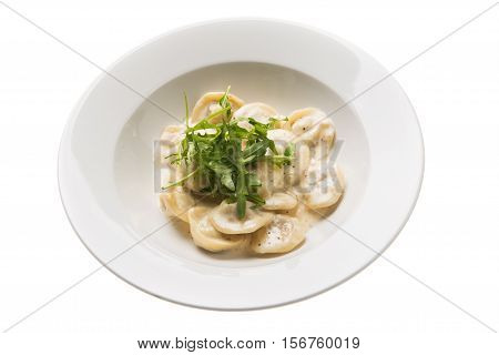 Italian Gnocchi With Gorgonzola Cheese And Arugula Isolated On White