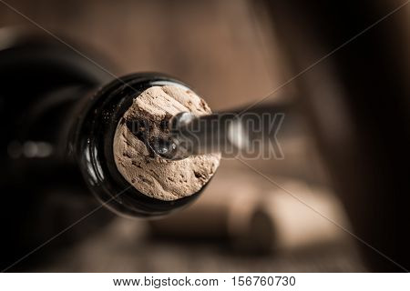 Corkscrew Screwed Into The Cork In The Bottle Of Wine.