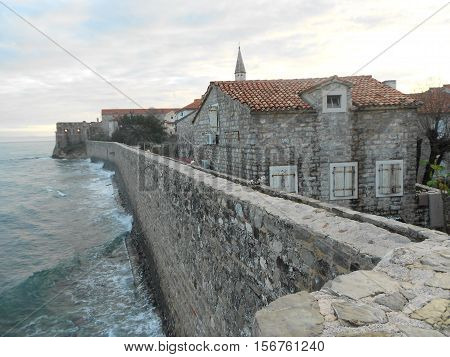 stone wall and old house kept away from the sea
