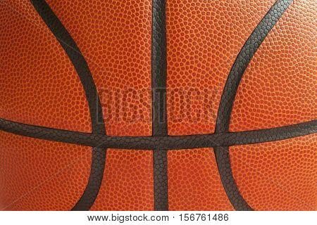Close up shot of a basketball showing the black seams