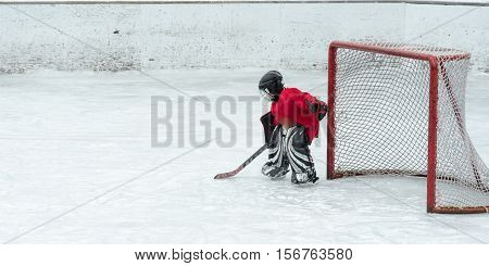 Lone goalie waits in anticipation as the offence gets closer to his net.