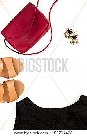 Flat lay of elegant feminine clothing and accessories. Little black dress nude sandals marsala bag and earrings. Fashion blog. Copy space for text