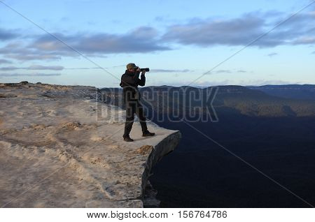Man Photographing The Landscape From Lincoln Rock Lookout At Sunrise Of The Grose Valley Located Wit