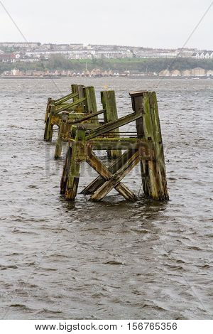 Old frames for mooring ships Cardiff Harbour Wales United kingdom.