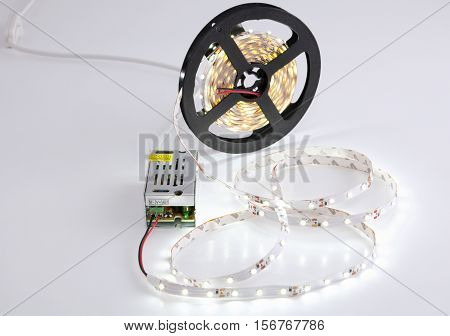 Coil luminous LED strip light and voltage transformer.