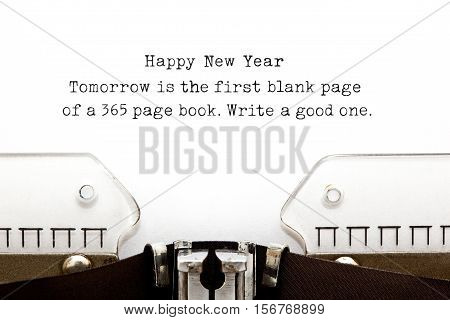 Tomorrow is the first blank page of a 365 page book. Write a good one. New Year quote printed on an old typewriter.