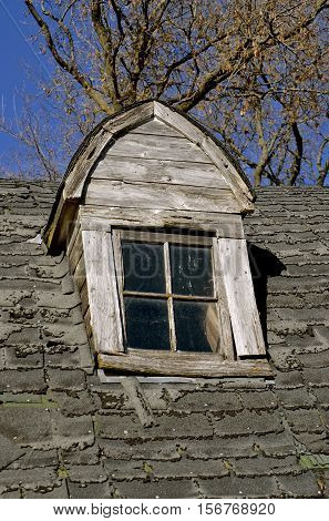Dormer of an old decaying roof needing shingles
