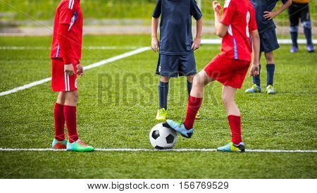 Young boys children in uniforms playing youth soccer football game tournament. Horizontal sport background