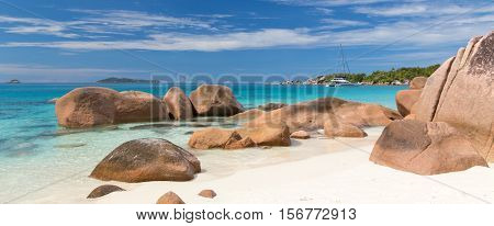 Catamaran boat on picture perfect tropical bay of Anse Lazio beach on Praslin Island, Seychelles.