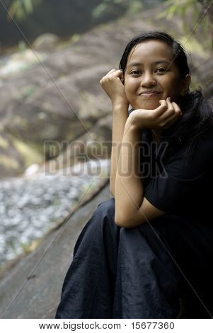 Happy smiling asian malay teen outdoors
