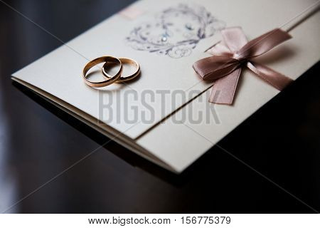 Wedding rings on the invitation card, wedding bands