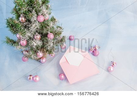Christmas Tree With Pink Open Envelope With Paper