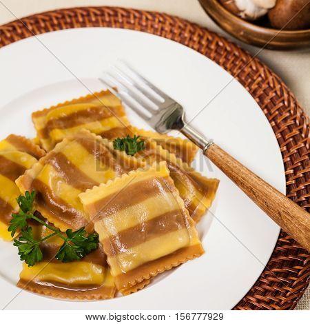 Homemade Striped Mushroom Cheese Ravioli. Selective focus.