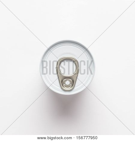 tin can overhead shot on white background. not isolated. current location concept.