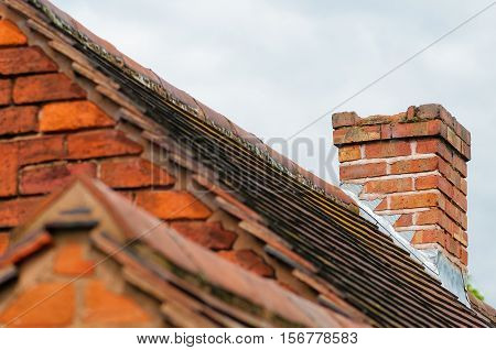 Damaged chimney needs repair old rooftop building exterior