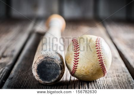 Baseball Bat And Ball On Old Wooden Table