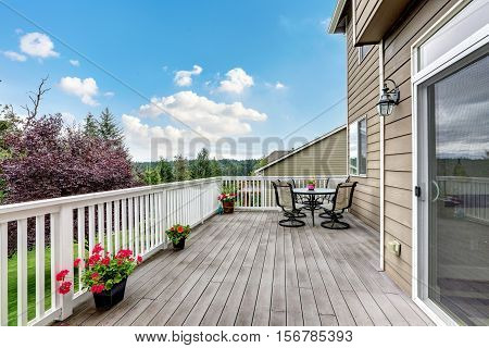 Wooden Walkout Deck With Beautiful Landscape View.