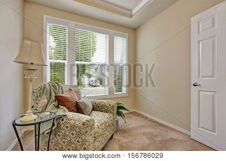 Small Sitting Room Interior With An Armchair