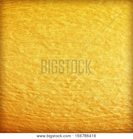 Gold paint on cement wall texture. golden texture background