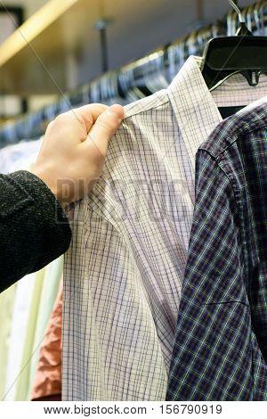 Male Hand Selecting Shirt