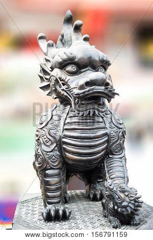 The sculpture of Dragon-headed unicorn. Thailand temple.