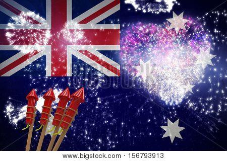 Rockets for fireworks against colourful fireworks exploding on black background