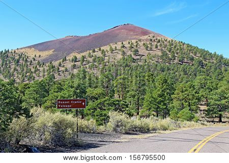 Sign and of the cinder cone at Sunset Crater Volcano National Monument north of Flagstaff Arizona