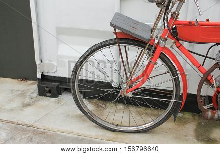 bicycle red vintage near of wall white background