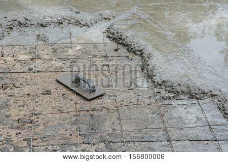 Workman plaster cement floor at construction site