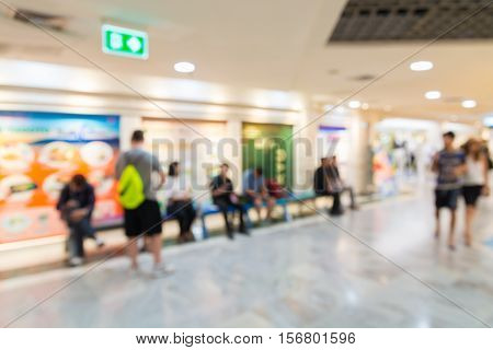 People rest and Walk in Modern Department Store or Shopping Mall