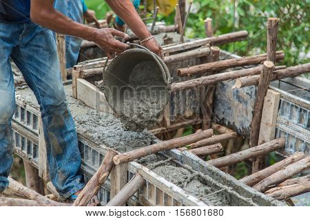 Concrete pouring during commercial concreting floors of buildings in construction(Commercial Building)