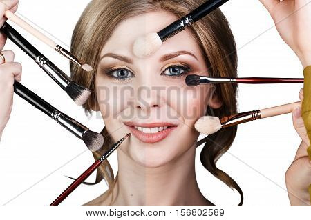Many hands with cosmetics brushes doing make-up to glamour woman, over white background