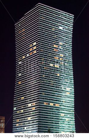 Modern the high-rise building with lights in the windows at night. Astana. Kazakhstan