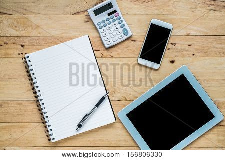 Flat lay blank open notebook and copy space. smartphone Tablet and other supplies Top view.