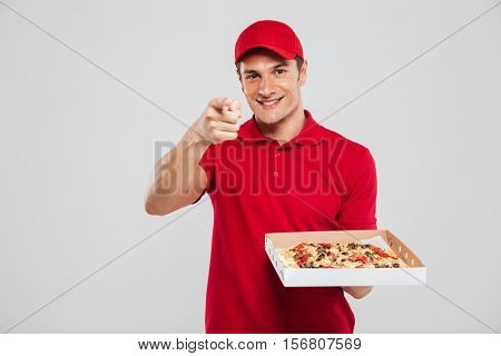 Image of pizza delivery man. isolated gray background
