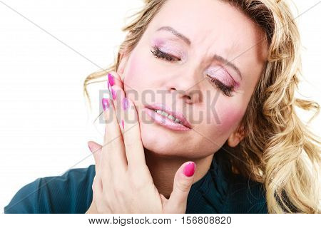 Aches and pains concept. Woman having bad ache and pain. Female feel tooth ache touching her mouth from outside by hand palm. Isolated on white.