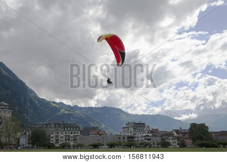 Tandem paragliding in bright blue sky in Interlaken Switzerland